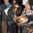 Maisie Williams and Sophie Turner sign autographs and take pictures with fans at LAX airport on March 26, 2013