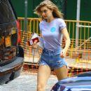 Gigi Hadid in Daisy Dukes – Returns home in New York City