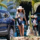 Doutzen Kroes in a cropped top and denim shorts in Ibiza - 454 x 326