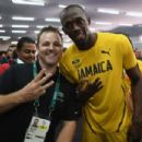 Photographer Meets Usain Bolt After 'Smiling Bolt' Image Goes Viral - 454 x 303