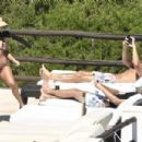 Kourtney Kardashian in Floral Bikini on the pool in Sardinia
