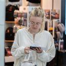 Dakota Fanning at Heathrow Airport in London