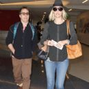 Leslie Bibb and Sam Rockwell departing on a flight at LAX airport in Los Angeles, California on January 26, 2015. The pair were all smiles as they made their way through the airport - 434 x 600