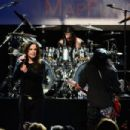 (L-R) Musicians Ozzy Osbourne, Tommy Clufetos and Slash perform onstage at the 10th annual MusiCares MAP Fund Benefit Concert at Club Nokia on May 12, 2014 in Los Angeles, California