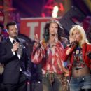 Host Ryan Seacrest, singer/songwriter Steven Tyler, and finalist Jax speak onstage during