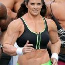 Danica Patrick displays bulky frame to film Super Bowl commercial..... but it's just a muscle suit - 306 x 787