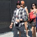 Actor Kellan Lutz, wearing an American Eagle plaid shirt, attends American Eagle Outfitters Celebrates the Budweiser Made in America Music Festival during day 1 at Los Angeles Grand Park on August 30, 2014 in Los Angeles, California
