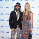 Musician Rob Zombie and Sherri Moon arrive at PETA's 35th Anniversary Party at Hollywood Palladium on September 30, 2015 in Los Angeles, California.