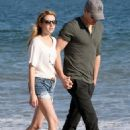 Strolling along the beach on Sunday (July 24) in Malibu, Calif