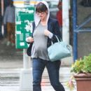 Pregnant actress Jennifer Love Hewitt and her fiance Brian Hallisay leaving their hotel on a rainy day in New York City, New York on August 22, 2013