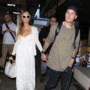 Paris Hilton and Chris Zylka at LAX Airport in LA