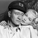 John Wayne and Lana Turner in The Sea Chase (1955)