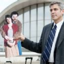 """Ryan Bingham (George Clooney, far right) holds up a cardboard photo of his sister Julie (Melanie Lynskey, far left) and her fiancé Jim (Danny McBride, near left) in the dramatic comedy """"Up in the Air,"""" a Paramount Pictures release. Photo Credi"""
