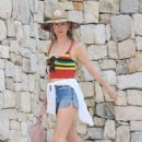 Behati Prinsloo in Jeans Shorts on the beach in Cabo San Lucas