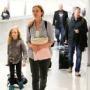 Marcia Cross and family seen at LAX - 454 x 588