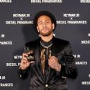 Neymar smoulders in a sleek black blazer, matching shorts and a gold-embellished shirt as he launches new Diesel fragrance - 454 x 611