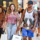 Still back on, then? Kelly Brook and David McIntosh go shopping in LA after Mexican getaway