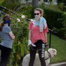 Olivia Wilde out for a stroll with her dog in Los Angeles