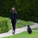 Troian Bellisario – Out for a walk with her dog in Los Angeles - 454 x 459