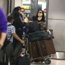 Dita Von Teese – Arrives at the airport in Miami - 454 x 468