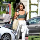 Olivia Culpo – Leaving a hair salon in West Hollywood