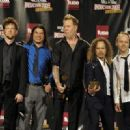 Metallica pose in the press room during the 24th Annual Rock and Roll Hall of Fame Induction Ceremony at Public Hall on April 4, 2009 in Cleveland, Ohio - 454 x 329