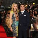 """Zac Efron and Taylor Schilling look close as they pose together on the red carpet for the European premiere of """"The Lucky One"""" in London"""