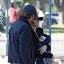 Tom Brady and Gisele Bundchen at a Palyground