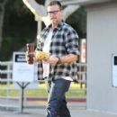 Tori Spelling and Dean McDermott stop by Gelson's Market for some coffee and some fruit in Encino, California on December 29, 2014