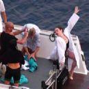 Emma Stone – Photoshoot for Louis Vuitton in Capri - 454 x 322