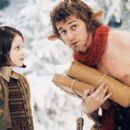 Georgie Henley  (Lucy Pevensie) and JamesMcAvoy (MrTumnus) in Walt Disney Pictures 2005 The Chronicles of Narnia: The Lion, the Witch and the Wardrobe.