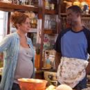 Deanne (Maya Rudolph) and Kurt McKenzie (Chris Rock) in the kitchen at the Lake House in Columbia Pictures' GROWN UPS. Photo By: Tracy Bennett. ©2009 Columbia TriStar Marketing Group, Inc. All Rights Reserved.
