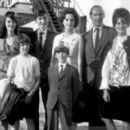July 29th, 1963 - The Rt Hon Sir David Ormsby-Gore KCMG went aboard the Queen Mary on her arrival today at Southhampton with his children Julian (22, dark glasses), Jane (20) and Victoria (16) to meet his wife Lady Ormsby-Gore, daughter Alice (11, with co - 454 x 270