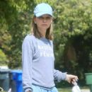 Calista Flockhart with her dogs out in Brentwood - 454 x 554