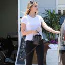 April Love Geary in Black Tights – Leaving a salon in Malibu - 454 x 681