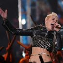"Miley Cyrus performs onstage during ""VH1 Divas"" 2012 at The Shrine Auditorium on December 16, 2012 in Los Angeles"