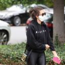 Nina Dobrev – In all black seen running errands in Los Angeles