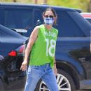Courteney Cox – Wears a green jersey type shirt in Malibu