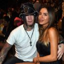 Guitarist Dj Ashba (L) of Guns N Roses and his wife, model Nathalia Henao, attend the UFC 175 event at the Mandalay Bay Events Center on July 5, 2014 in Las Vegas, Nevada - 454 x 339
