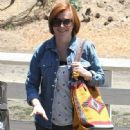Couple Alyson Hannigan and Alexis Denisof spend some time together at a park in Brentwood, California on July 17, 2015 - 448 x 600