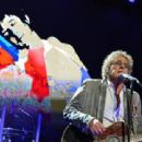 The Who's Roger Daltrey and Pete Townshend perform during The Who Cares Benefit on February 28, 2013