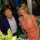 Mick Jagger and actress Laura Dern attend HBO's Annual Primetime Emmy Awards Post Award Reception at The Plaza at the Pacific Design Center on September 22, 2013 in Los Angeles, California - 454 x 363