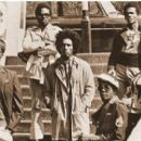 VINTAGE APPEAL: Bob Marley and The Wailers, circa 1975. Below: Roger Steffens