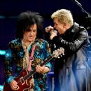 Musician Steve Stevens and singer Billy Idol perform onstage during the first ever iHeart80s Party at The Forum on February 20, 2016 in Inglewood, California. - 450 x 600