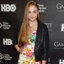Sophie Turner posing for photos and signing autographs at the 'Game Of Thrones' The Exhibition New York Opening in New York