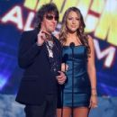 Richie Sambora and Colbie Caillat onstage during the 2008 American Music Awards on November 23, 2008 in Los Angeles, CA - 421 x 594
