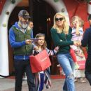 Busy Phillips goes holiday shopping with her family at The Grove in Los Angeles, California on December 10, 2016 - 451 x 600