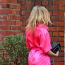 Kylie Minogue – In an electric pink silk outfit in South London