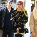 Lindsay Lohan – Arrives at JFK Airport in New York City - 454 x 864