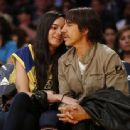 That's one Red Hot smooch! Anthony Kiedis, 52, shares passionate courtside kiss with Brazilian model Wanessa Milhomem, 22, at the LA Lakers game - 454 x 338